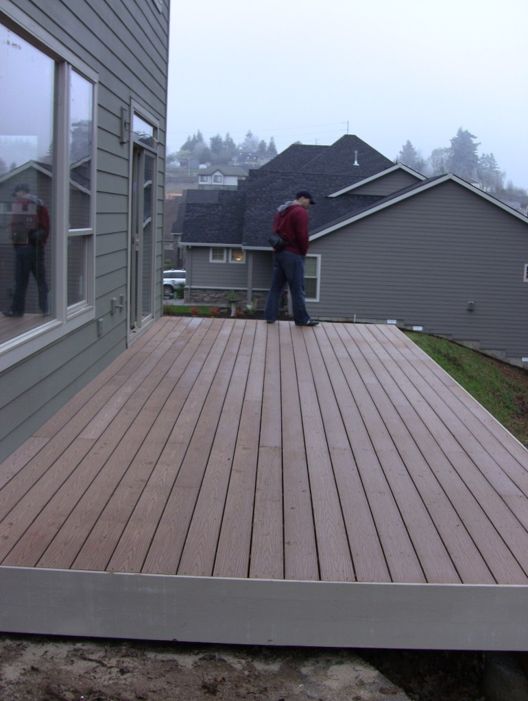 12/10/11. The much discussed and revised deck. Yay! We can entertain out back without people tumbling down a hill!