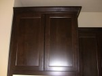 12/24/11. Beech wood cabinets with a coffee colored rustic finish.