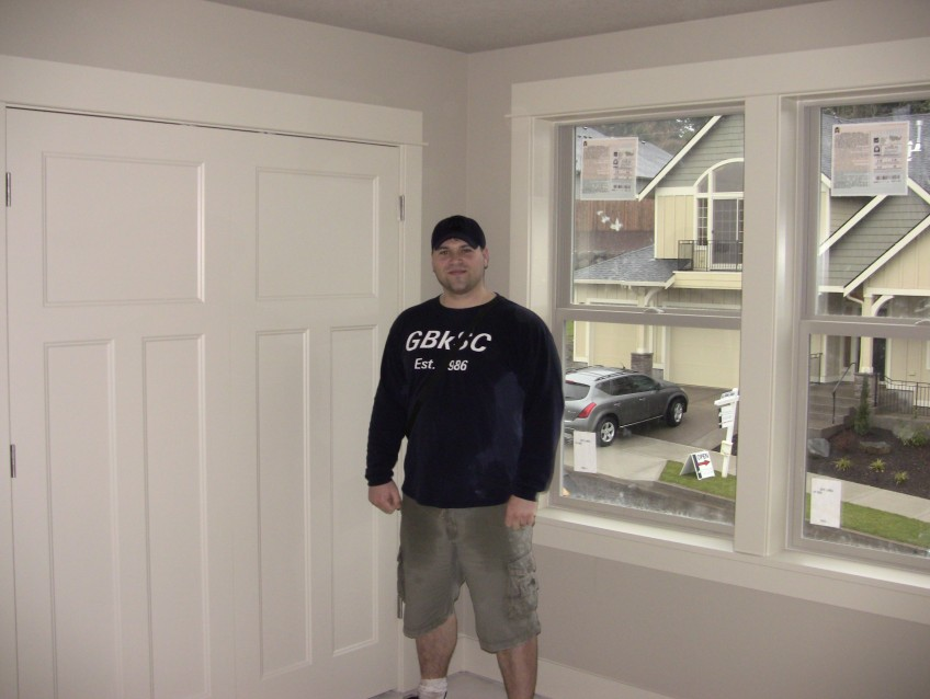 1/29/12. So cute. Nick posing with a big grin in the future nursery!